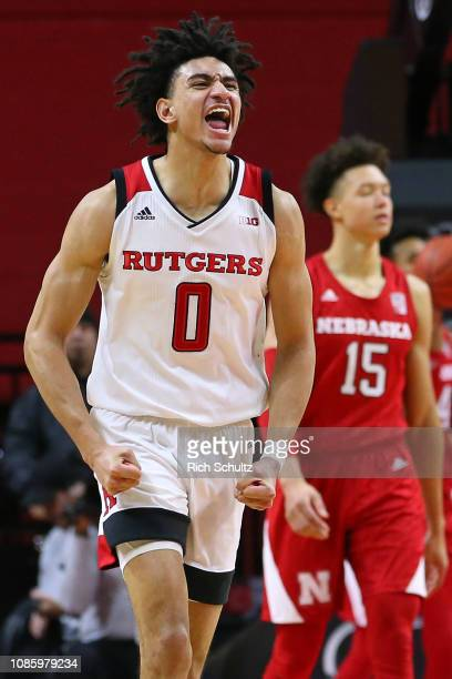 Geo Baker of the Rutgers Scarlet Knights reacts after scoring a threepoint basket against the Nebraska Cornhuskers during the second half of a game...
