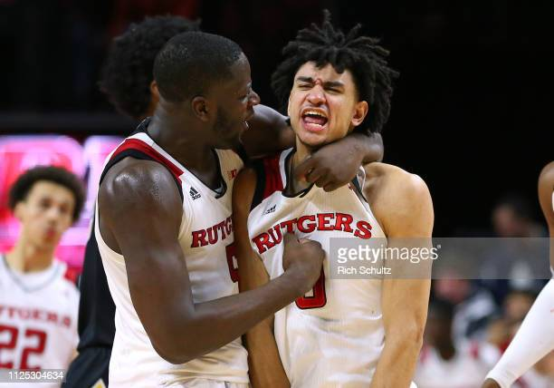 Geo Baker of the Rutgers Scarlet Knights reacts and is hugged by Eugene Omoruyi after he scored a three-point basket for a one point lead with 3.2...