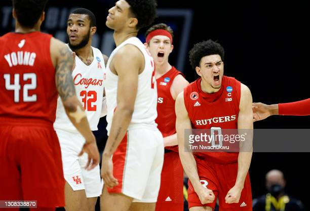 Geo Baker of the Rutgers Scarlet Knights reacts during the second half against the Houston Cougars in the second round game of the 2021 NCAA Men's...