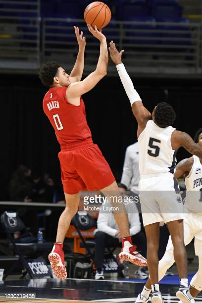 Geo Baker of the Rutgers Scarlet Knights takes a shot over Jamari Wheeler of the Penn State Nittany Lions in the first half during a college...