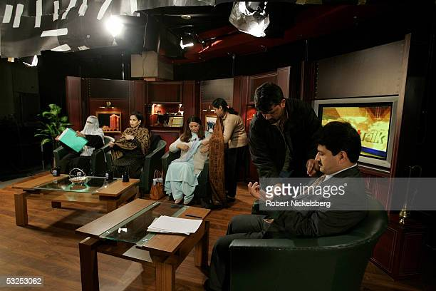 Geo TV's Islamabad Bureau Chief Hamid Mir has a remote microphone attached before hosting Geo TV's Islamabad Bureau's hour long political talk show...