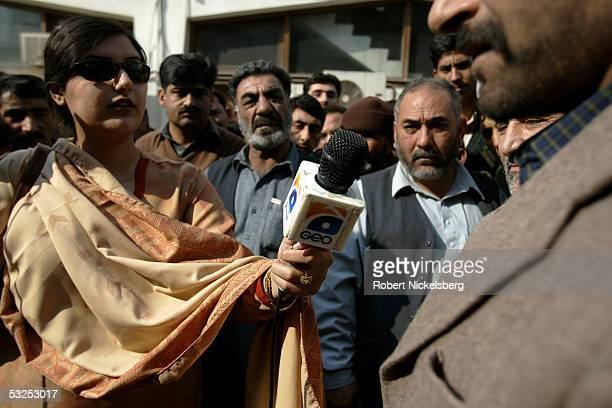 Geo TV's Islamabad reporter Umbreen Fazal interviews stranded passengers outside the Pakistan International Airways ticketing office January 18 2005...