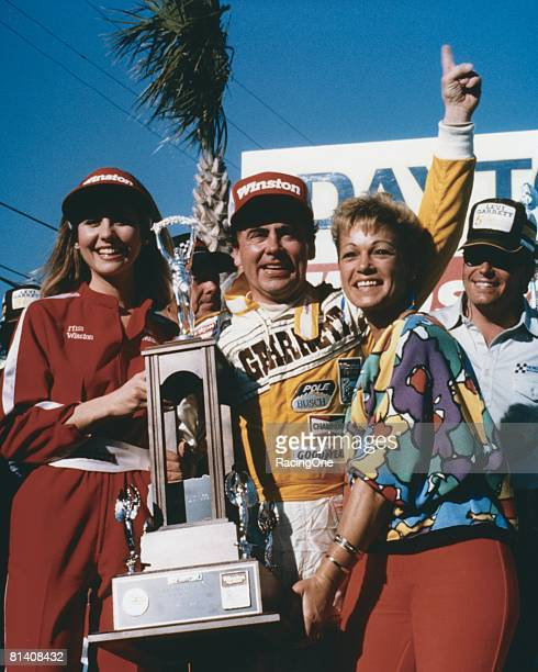 Geoff Bodine driver of the Levi Garrett Chevrolet celebrates in victory lane after winning the Winston Cup Daytona 500 on February 16, 1986 at the...