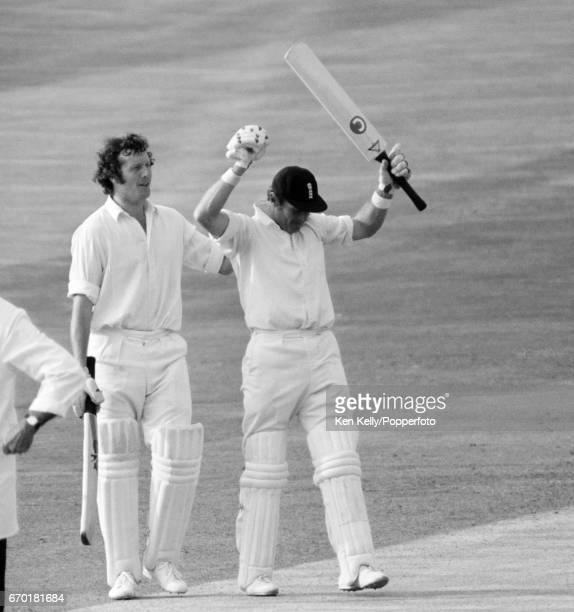 Geoff Boycott of England is congratulated by Graham Roope after completing his 100th century during the 4th Ashes Test match between England and...