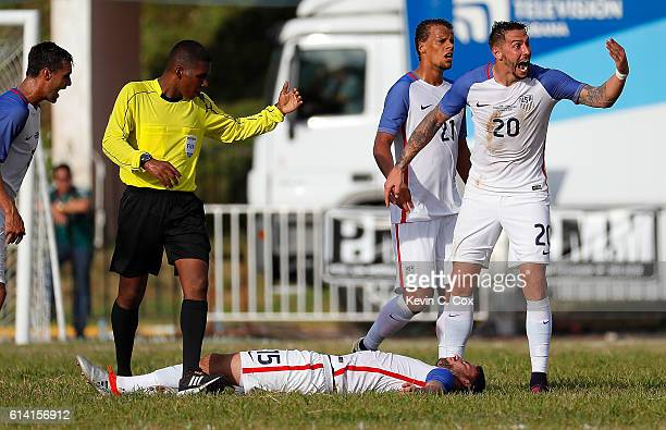 Geoff Cameron Chris Wondolowski and Timmy Chandler of the United States react after Steven Birnbaum took a boot to the head against Cuba at Estadio...