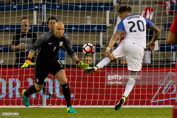 Geoff Cameron knocks the ball away from Brad Guzan of USA after a Bolivia player deflected the ball in the second half of an international friendly...