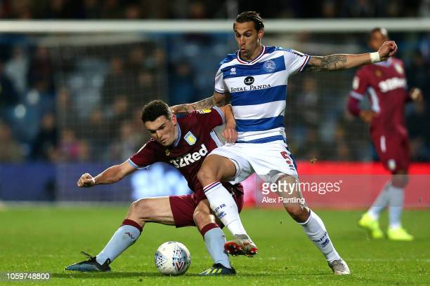 Geoff Cameron of QPR is closed down by John McGinn of Aston Villa during the Sky Bet Championship match between Queens Park Rangers and Aston Villa...