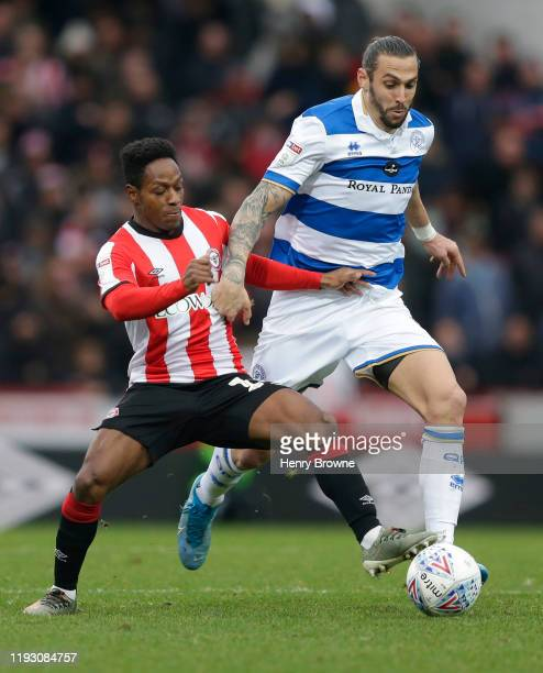 Geoff Cameron of Queens Park Rangers and Joel Valencia of Brentford during the Sky Bet Championship match between Brentford and Queens Park Rangers...