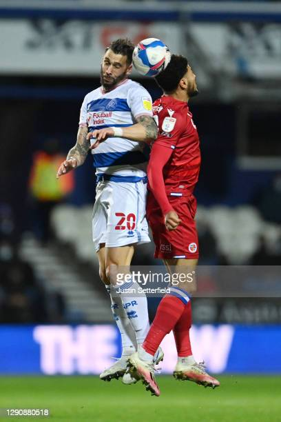 Geoff Cameron of Queens Park Rangers and Josh Laurent of Reading FC battle for the ball during the Sky Bet Championship match between Queens Park...