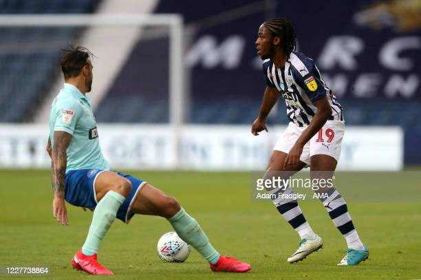 Geoff Cameron of Queens Park Rangers and Romaine Sawyers of West Bromwich Albion during the Sky Bet Championship match between West Bromwich Albion...