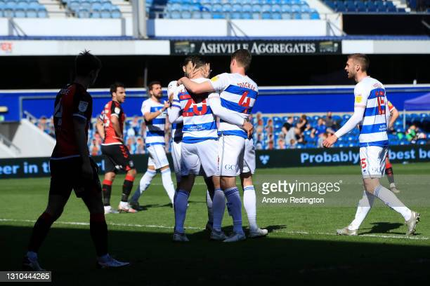 Geoff Cameron of Queens Park Rangers celebrates with team mates after scoring their side's second goal during the Sky Bet Championship match between...