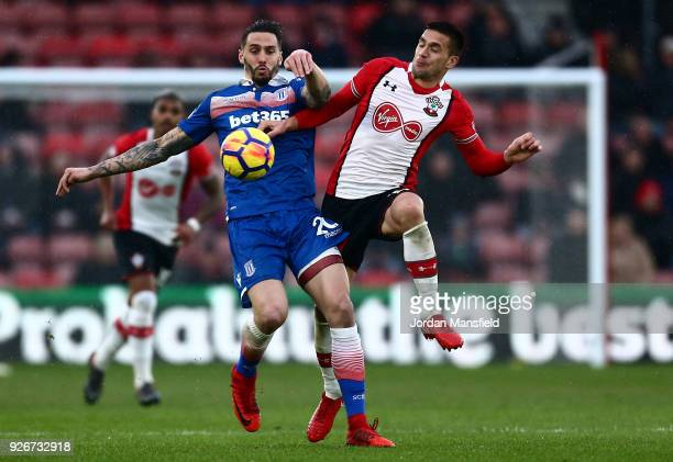 Geoff Cameron of Stoke City and Dusan Tadic of Southampton battle for the ball during the Premier League match between Southampton and Stoke City at...