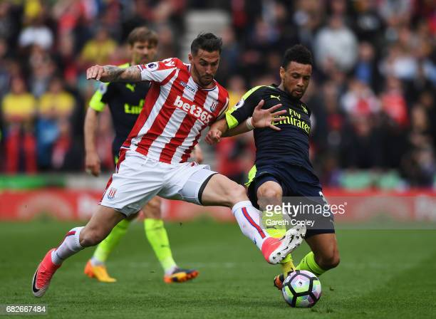 Geoff Cameron of Stoke City and Francis Coquelin of Arsneal battle for possession during the Premier League match between Stoke City and Arsenal at...