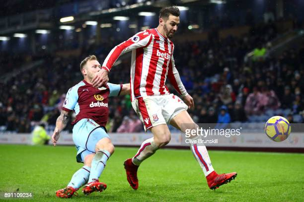 Geoff Cameron of Stoke City and Scott Arfield of Burnley clash in action during the Premier League match between Burnley and Stoke City at Turf Moor...