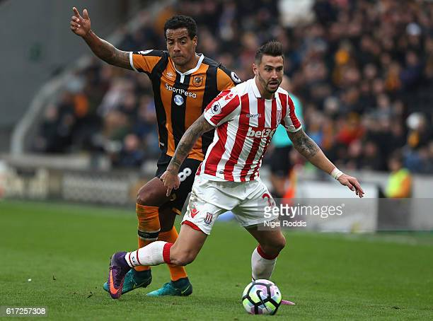 Geoff Cameron of Stoke City and Tom Huddlestone of Hull City compete for the ball during the Premier League match between Hull City and Stoke City at...