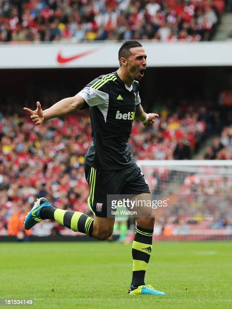 Geoff Cameron of Stoke City celebrates scoring during the Barclays Premier League match between Arsenal and Stoke City at Emirates Stadium on...