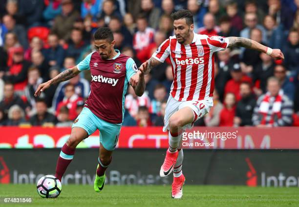 Geoff Cameron of Stoke City closes down Manuel Lanzini of West Ham United during the Premier League match between Stoke City and West Ham United at...