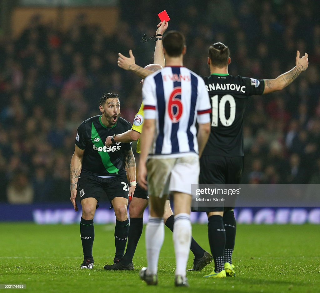 Geoff Cameron (1st L) of Stoke City reacts after being shown a red card by referee Lee Mason during the Barclays Premier League match between West Bromwich Albion and Stoke City at The Hawthorns on January 2, 2016 in West Bromwich, England.