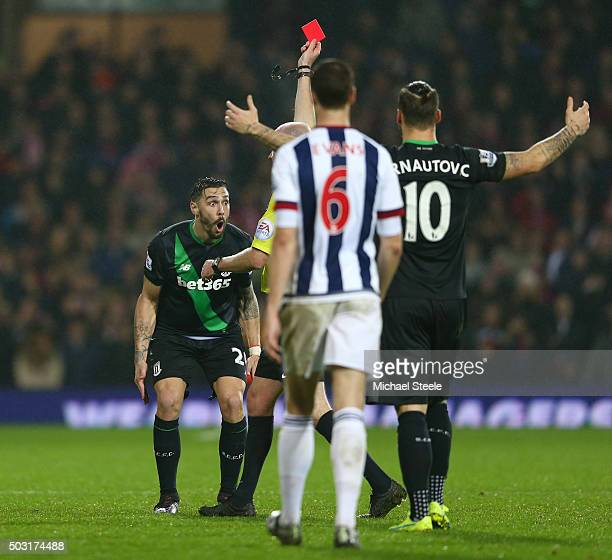 Geoff Cameron of Stoke City reacts after being shown a red card by referee Lee Mason during the Barclays Premier League match between West Bromwich...