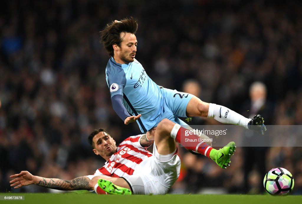 Geoff Cameron of Stoke City tackles David Silva of Manchester City during the Premier League match between Manchester City and Stoke City at Etihad Stadium on March 8, 2017 in Manchester, England.
