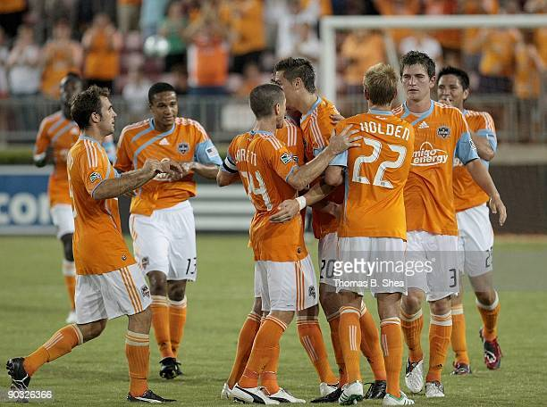Geoff Cameron of the Houston Dynamo celebrates his goal against goalie Kaser Keller of the Seattle Sounders FC at Robertson Stadium on August 23 2009...