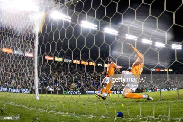 Geoff Cameron of the Houston Dynamo is unsuccessful in his attempt to clear a shot by Landon Donovan of the Los Angeles Galaxy giving the Galaxy a 10...
