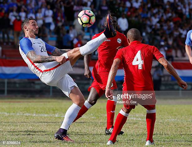 Geoff Cameron of the United States attempts a shot on goal against Yasmani Lopes Escalante of Cuba at Estadio Pedro Marrero on October 7 2016 in...