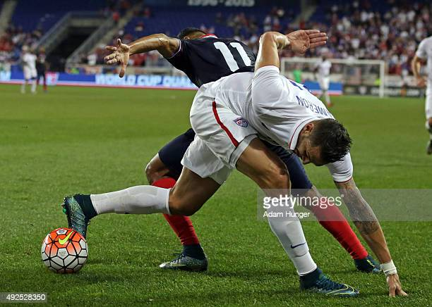 Geoff Cameron of the United States battles for the ball with Johan Venegas of Costa Rica during the first half at Red Bull Arena on October 13 2015...