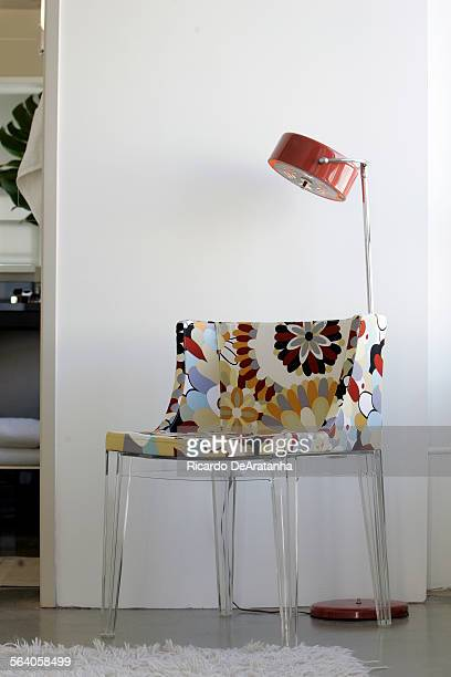 Geoff Clark's unit in the Eastern Columbia building has a young hip modern vibe with pieces such as this acrylic chair and vintage lamp purchased for...