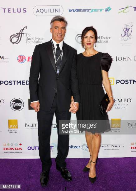 Geoff Courtnall and Penni Courtnall arrive for the David Foster Foundation Gala at Rogers Arena on October 21 2017 in Vancouver Canada