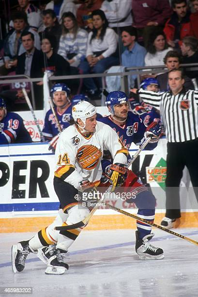 Geoff Courtnall of the Vancouver Canucks battles for position with Mike Gartner of the New York Rangers on February 17 1992 at the Madison Square...