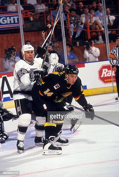 Geoff Courtnall of the Vancouver Canucks battles for position with Mark Hardy of the Los Angeles Kings on October 6 1993 at the Great Western Forum...