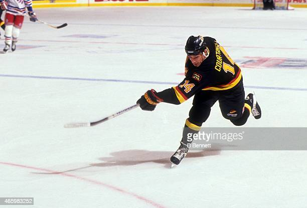 Geoff Courtnall of the Vancouver Canucks shoots during Game 1 of the 1994 Stanley Cup Finals against the New York Rangers on May 31 1994 at the...