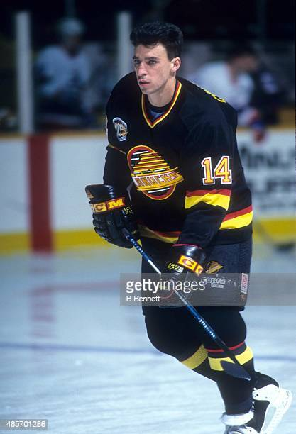 Geoff Courtnall of the Vancouver Canucks skates on the ice before an NHL game against the Winnipeg Jets on March 14 1995 at the Winnipeg Arena in...