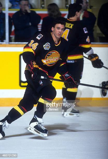 Geoff Courtnall of the Vancouver Canucks skates on the ice before an NHL game against the Toronto Maple Leafs circa 1994 at the Maple Leaf Gardens in...