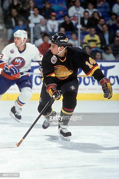 Geoff Courtnall of the Vancouver Canucks skates on the ice during an NHL game against the New York Islanders on January 9 1993 at the Nassau Coliseum...