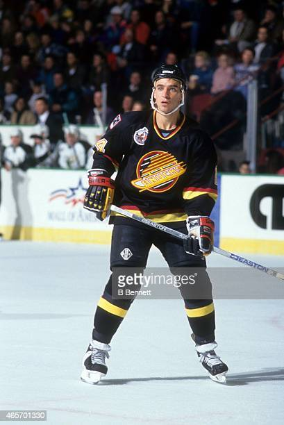 Geoff Courtnall of the Vancouver Canucks skates on the ice during an NHL game against the Minnesota North Stars on November 25 1992 at the Met Center...