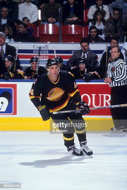 Geoff Courtnall of the Vancouver Canucks skates on the ice during an NHL game against the Quebec Nordiques on December 4 1993 at the Quebec Coliseum...