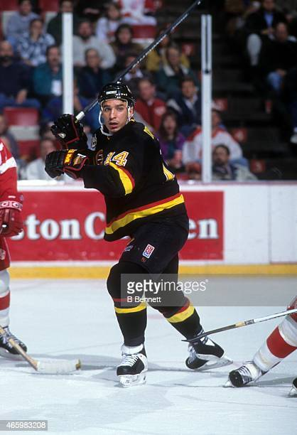 Geoff Courtnall of the Vancouver Canucks skates on the ice during an NHL game against the Detroit Red Wings on March 17 1995 at the Joe Louis Arena...