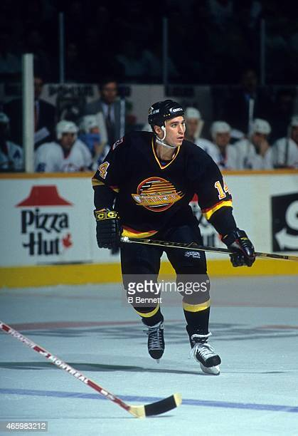 Geoff Courtnall of the Vancouver Canucks skates on the ice during an NHL game against the Winnipeg Jets on November 26 1993 at the Winnipeg Arena in...