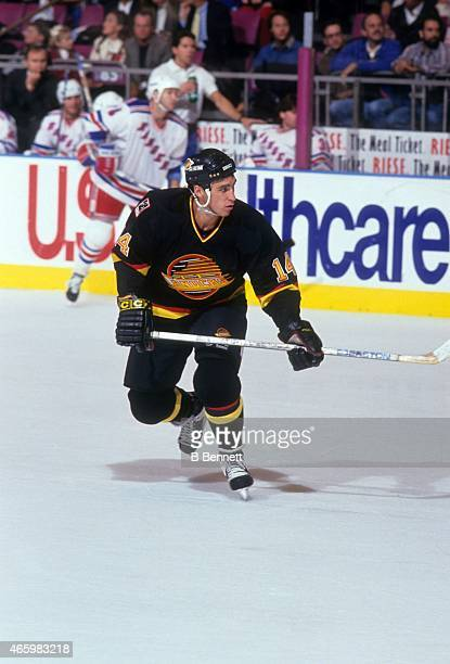 Geoff Courtnall of the Vancouver Canucks skates on the ice during an NHL game against the New York Rangers on November 3 1993 at the Madison Square...