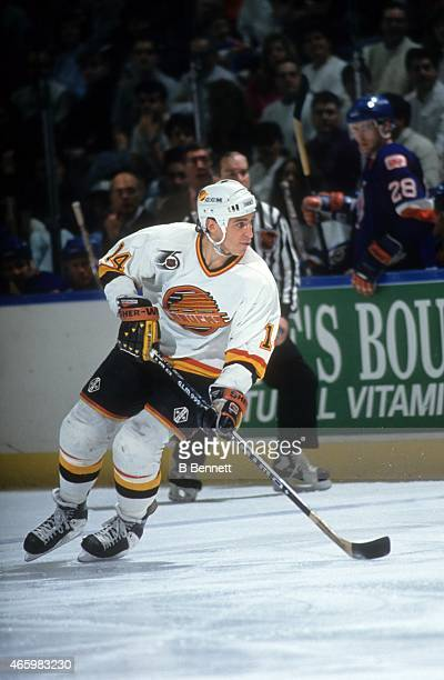Geoff Courtnall of the Vancouver Canucks skates on the ice during an NHL game against the New York Islanders on February 15 1992 at the Nassau...