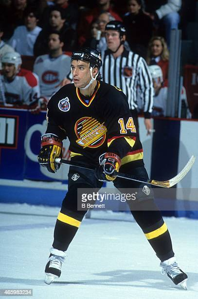Geoff Courtnall of the Vancouver Canucks skates on the ice during an NHL game against the Montreal Canadiens on November 28 1992 at the Montreal...