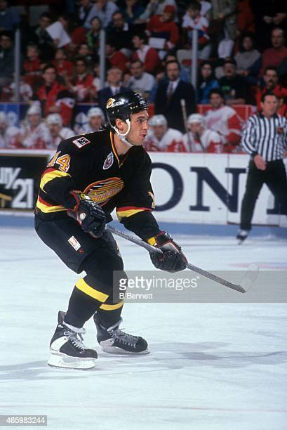 Geoff Courtnall of the Vancouver Canucks skates on the ice during an NHL game against the Detroit Red Wings on April 3 1993 at the Joe Louis Arena in...