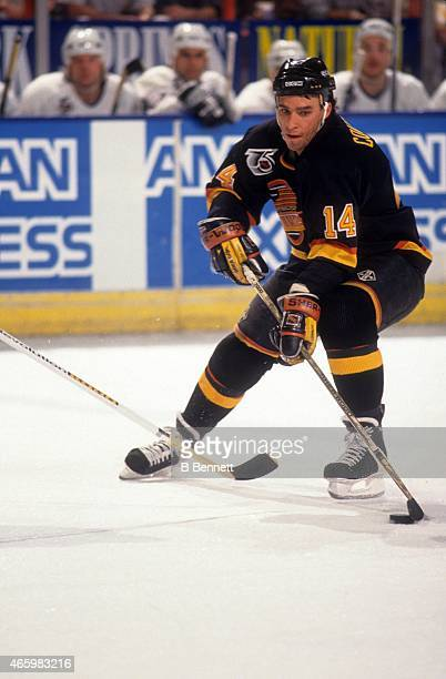 Geoff Courtnall of the Vancouver Canucks skates with the puck during an NHL game against the Los Angeles Kings on December 14 1991 at the Great...