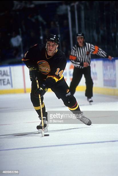 Geoff Courtnall of the Vancouver Canucks skates with the puck during an NHL game against the New York Islanders on November 2 1993 at the Nassau...