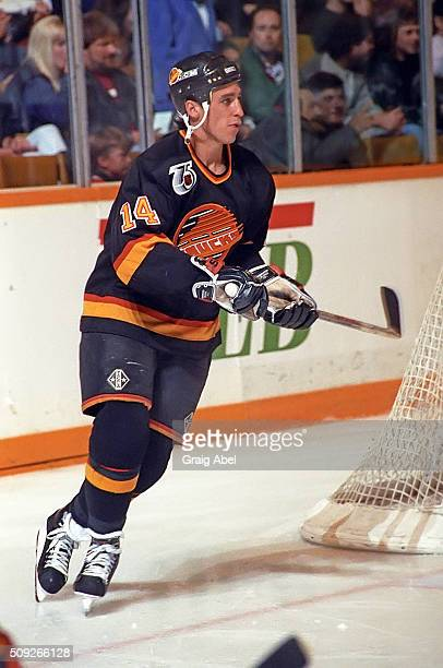 Geoff Courtnall of the Vancouver Canucks turns up ice against the Toronto Maple Leafs during NHL game action at Maple Leaf Gardens in Toronto Ontario...