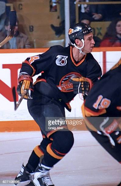 Geoff Courtnall of the Vancouver Canucks turns up ice against the Toronto Maple Leafs during NHL game action on December 7 1991 at Maple Leaf Gardens...
