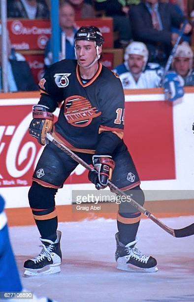 Geoff Courtnall of the Vancouver Canucks watches the play develop against the Toronto Maple Leafs during NHL game action on December 7 1991 at Maple...