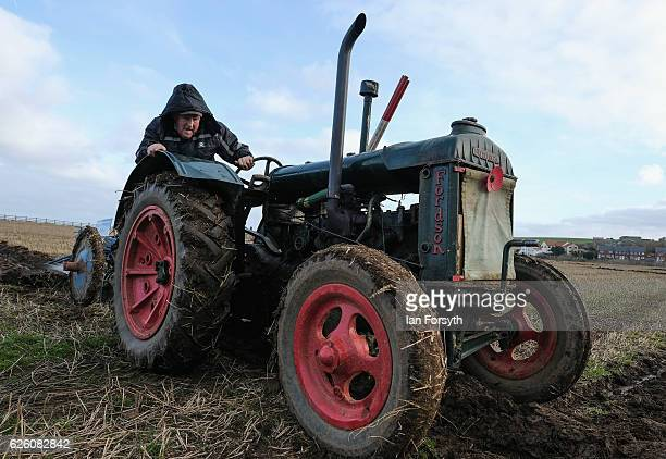 Geoff Dibb from Otley drives his Fordson tractor during the annual ploughing match on November 27, 2016 in Staithes, United Kingdom. The event which...